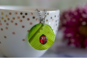 Banana leaf with ladybird necklace